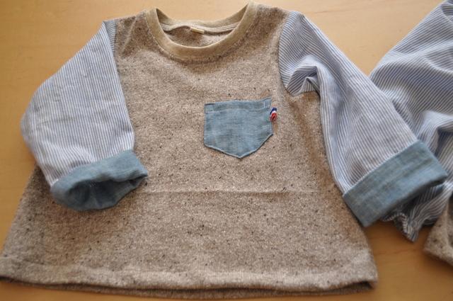 胸元に小さなポケット、袖口は見返し付き。