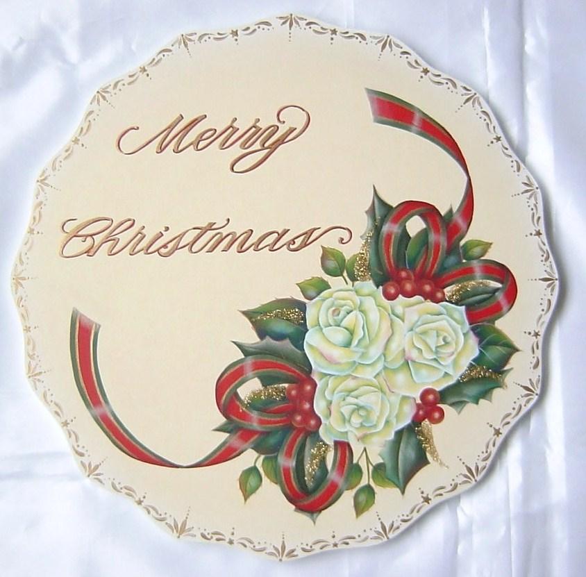 """バラが印象的な豪華なクリスマスプレートはとても人気があります。リボンも華やかに描きましょう。拡大して大きなウッドで描かれる事をお勧めします。<p><font color=""""#ff0000"""">デザインの著作権は神谷冨益子にあります。画像を拡大してのペイント、類似品の作成は固くお断りいたします。</font></p>"""