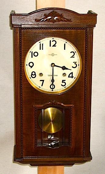 精工舎の側面窓付柱時計、希少な保険証付。昭和27年に製造された物です。